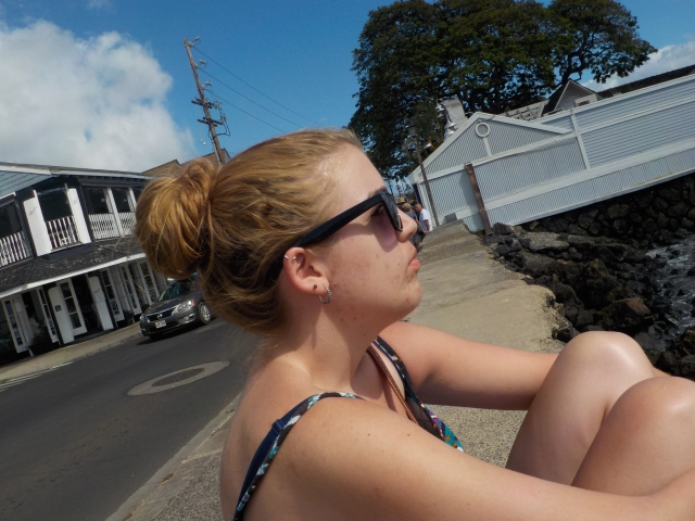 Sitting on the sea wall in Lahaina